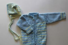 Retro Handknit Baby Blue and Yellow Cardigan with Hat royalty free stock photo