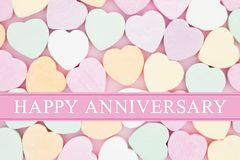 Retro Happy Anniversary greeting with candy hearts stock image