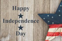Retro Happy Independence Day Greeting. Happy Independence Day Greeting, USA patriotic old star on a weathered wood background with text Happy Independence Day royalty free stock photography