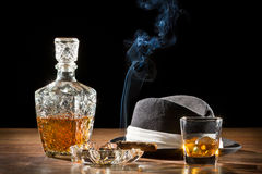 Retro hat, smoking cigar and whisky on rock Royalty Free Stock Images