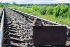 Retro hat and suitcase on railroad. Retro hat and suitcase on railways royalty free stock photos