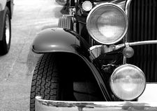 Retro headlight lamp vintage classic car parked in old city street Royalty Free Stock Images