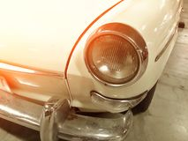 Retro headlight of vintage car, vintage light effect Royalty Free Stock Photo