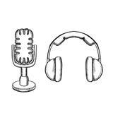 Retro headphones and desktop microphone Stock Photography