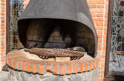 Retro hearth fireplace brick wall outdoor closeup Stock Photography