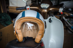 Retro helmet on the scooter Royalty Free Stock Photography
