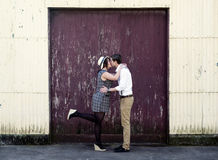 Retro hip hipster romantic love couple kissing industrial setting Royalty Free Stock Photo