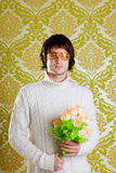 Retro hip man holding valentines flowers Royalty Free Stock Photo