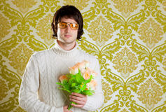 Retro hip man holding valentines flowers Stock Photos