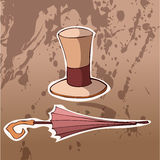 Retro Hoed en Paraplu op een Bruine Achtergrond Royalty-vrije Stock Afbeelding