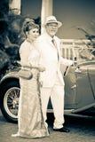 Retro hogere familie op de Uitstekende Parade van de Auto Royalty-vrije Stock Afbeelding