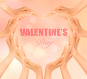 Retro holiday background with hands making a heart. Royalty Free Stock Image