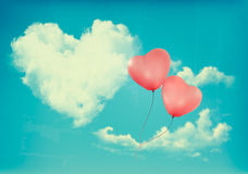 Retro Holiday background with heart shaped cloud on blue sky Royalty Free Stock Images
