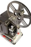 Retro or vintage home movie projector. A retro home movie projector dirty from storage isolated on a white background royalty free stock photography