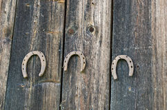 Retro horse shoes hang nail wooden rural wall Royalty Free Stock Images