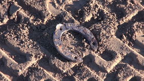 Retro  horseshoe and agriculture tractor traces on soil Royalty Free Stock Image