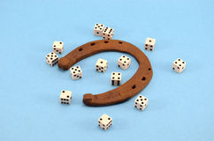 Retro horseshoe gamble dice concept blue Stock Photo