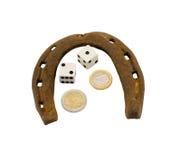 Retro horseshoe gamble dice euro coins isolated Stock Images