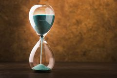 Retro hourglass. With two transparent flask with sand on background. Time passing concept Stock Photos