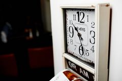 Retro hours on the wall. Close-up photo of retro hours on the wall Stock Photography