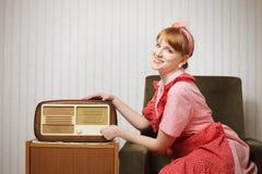 Retro House Wife Listening To The Radio Royalty Free Stock Image