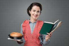 Retro housewife with cookbook Stock Images