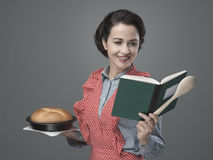 Retro housewife with cookbook Royalty Free Stock Photo