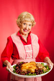 Retro Housewife Cooks Holiday Meal Royalty Free Stock Image