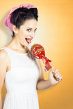 Retro housewife craving sweet candy Royalty Free Stock Photography