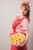Beautiful woman holding italian pie. Stock Image
