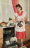 Retro housewife at home Stock Photos