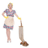 Retro housewife, with vintage vacuum cleaner, isolated on white,. Stressed retro housewife, with vintage vacuum cleaner, isolated on white Royalty Free Stock Photography