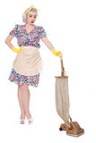 Retro housewife, with vintage vacuum cleaner, isolated on white. Tired retro housewife, with vintage vacuum cleaner, isolated on white Royalty Free Stock Image