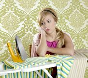 Retro housewife vintage woman clotes iron tired. Retro housewife vintage woman with ironing board looking tired Stock Photos