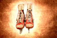 Retro ice skates on leather textured background Royalty Free Stock Photography