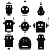 Retro icone d'annata delle teste dei robot messe in bianco e nero Fotografie Stock