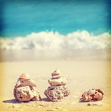 Retro image of coral pyramids on beach. Royalty Free Stock Images