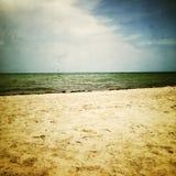 Retro image of gloomy sea and beach Stock Photos