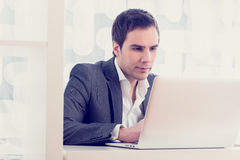 Retro image of a handsome young businessman typing or working on Stock Images