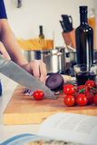 Retro image of ingredients for pasta and hands chopping tomatos Stock Photo