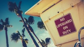 Retro Style Californian Lifeguard Station. Retro Image Of A Lifeguard Station Or Tower On A Beach In California With Palm Trees royalty free stock images