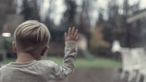 Retro image of one young child in front of a window Royalty Free Stock Photography
