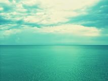 Retro image of sea and sky in green shades Royalty Free Stock Photo