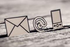 Retro image of At sign, mail and phone symbols Royalty Free Stock Images