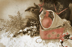 Retro image of sleigh with christmas ornaments in the bag Stock Photo