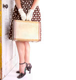 Retro image of woman holding luggage Royalty Free Stock Photography