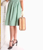 Retro image of woman holding luggage Royalty Free Stock Images