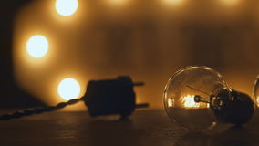 Retro incandescent bulbs and plug. lighting in loft style. Light decor. Retro incandescent bulbs and plug. Electricity light on the table. Industrial light bulbs Royalty Free Stock Images