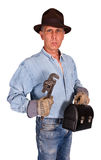 Retro Industrial Factory Worker Blue Collar Man. Joe Lunchbucket factory worker. This man portrays a vintage industrial blue collar work. In the scene is a royalty free stock image