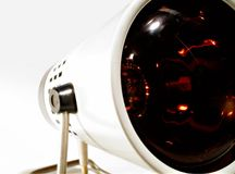 Retro - infra red health lamp. Focused on the big red lamp Stock Image